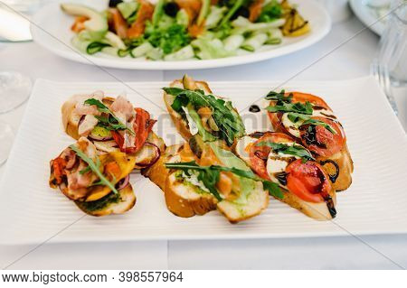 Gourmet Appetizers, Photo Of Sandwich On Plate, Crostini With Different Toppings. Delicious. Front V