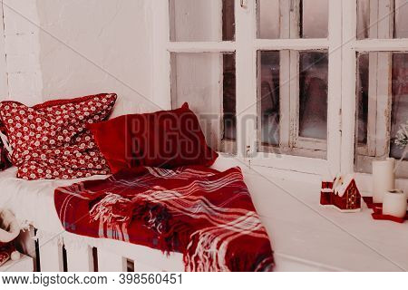 Pillows And Warm Knitted Plaid On A Windowsill, A Cozy Corner, A Cozy Window Sill.
