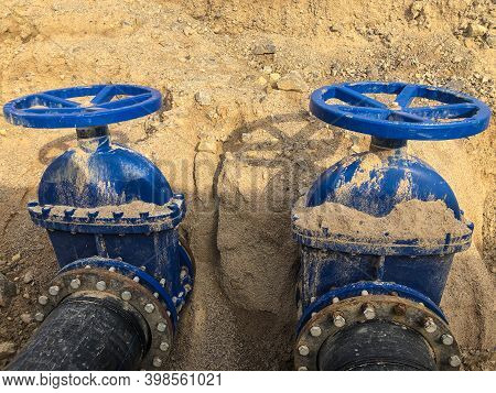 Valves On Pipeline In Ground. Pipe Valves In Trench
