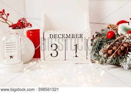 Wooden Cubes With The Inscription December 31 On A Christmas Background.