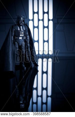 DEC 5 2020: Reflections of Sith lord Darth Vader from Star Wars in a Death Star hallway - Hasbro action figure