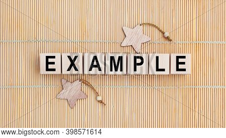 Example - Word Written On Wood Block. Example Text On Table, Concept.
