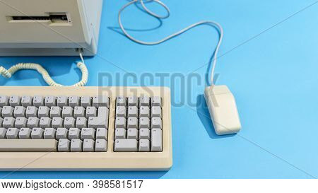 Personal Computer With Keyboard And Mouse. Old Desktop Computer On A Blue Background