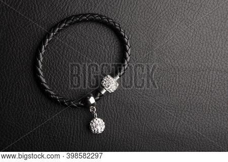 Image Of Bracelet Dark Leather Background Studio