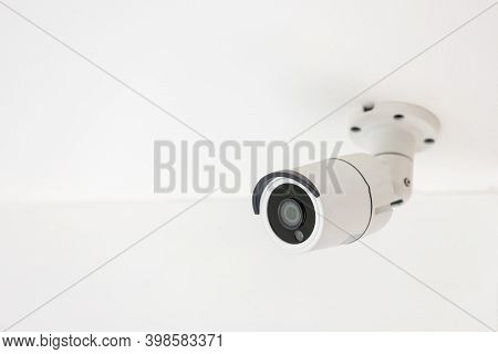 Security Cctv Camera Surveillance System Indoor Of House. A Blurred Night Cityscape Background. Mode