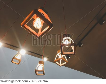 Decorative Fixture, Light Bulb And Lamp In Modern Style Hanging From The Ceiling On White Background