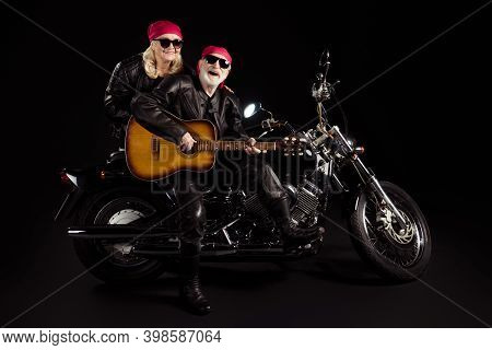 Photo Of Aged Bikers Man Lady Couple Sit Chopper Moto Feel Young Rock Bike Festival Meeting Play Sin
