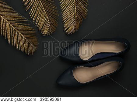 Women's Classic Leather High Heel Shoes On A Black Background With Gold Palm Leaves. Rich Concept. F