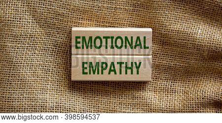 Emotional Empathy Symbol. Wooden Blocks Form The Words 'emotional Empathy' On Beautiful Canvas Backg