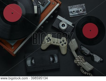 Flat Lay Retro Media And Entertainment. Vinyl Record Player With Vinyl Record, Film Camera, Video Ca