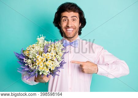 Photo Of Cheerful Positive Curly Wavy Hair Fiance Wear Pink Outfit Pointing Bunch Flowers Isolated T