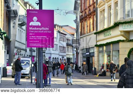 Heidelberg, Germany - December 2020: Signs For Face Mask And Distance Requirement In German City Cen