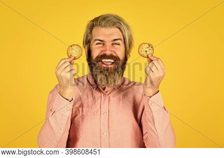 Excited Man Holding Cookies. Bearded Hipster Hold Biscuit. Full Of Calorie. Concept Of Harmful Food.