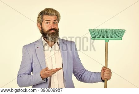 Businessman Sweeping Office. Unemployment And Business Reduction. Staff Reductions Concept. Business