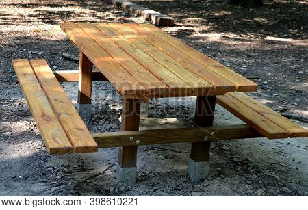 Wooden Picnic Bench Joined Table And Benches Together. Bright Spruce Wood With Metal Feet. Metal Fee