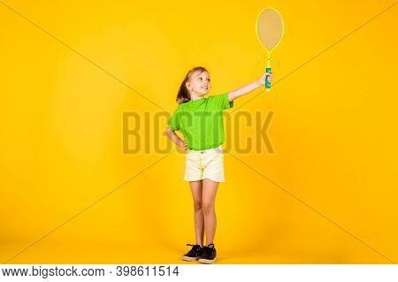 Cute Child Play Tennis Or Badminton. Active Way Of Life. Full Of Energy. Beautiful Teen Girl With Te