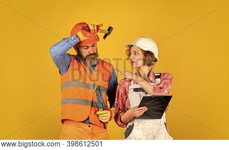 Redevelopment Of Home. Renovation Concept. Couple Planning Changes Renovation Apartment. Couple Look
