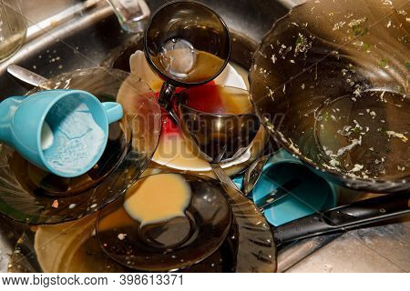 Pile Of Dirty Dishes In The Sink. Unsanitary