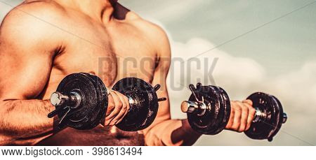 Muscles With Dumbbell. Man Training With Dumbbells. Dumbbell. Muscular Bodybuilder Guys, Exercises W