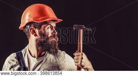 Hammer Hammering. Builder In Helmet, Hammer, Handyman Builders In Hardhat