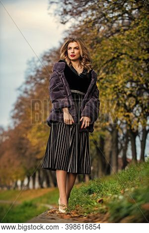 Glamorous Lady. Cosy Autumn Outfit. Winter Fashion Trends. Sexy Woman Red Lips Wear Fur Coat. Luxury