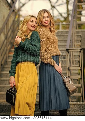 Completing Each Other. Matching Outfits. Women Sisters Outdoors Stairs Background. Vogue Concept. Gi