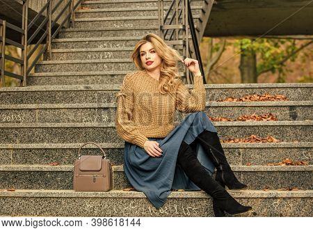 Fall Fashion Trend. Wearable Trends. Layer Oversize Knit Over Girly Skirt. Fall Outfit Formula. How