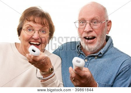 Happy Senior Couple Play Video Game with Remote Controls On a White Background.