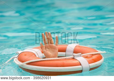 The Concept Of Help, Rescue, Drowning, Storm. Thrown Life Buoy Saving Drowning Person. Life Buoy. Li