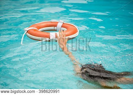 Life Buoy, Concept Of Help, Rescue. Lifebuoy In Water. Life Ring Floating In A Sea, Life Preserver.