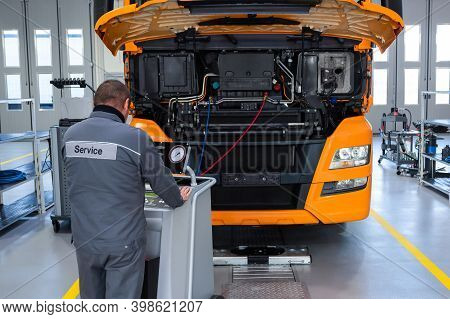 Truck On Computer Diagnostics In A Car Service. Service And Repair Of Trucks In A Large Garage. Car