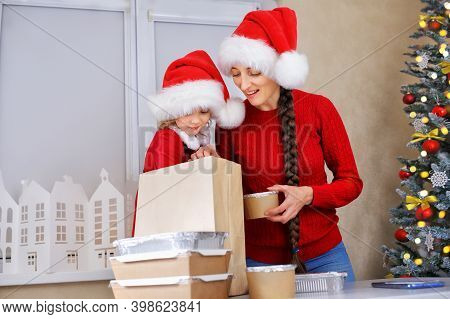 A Mother And Her Daughter In Santa Helpers Cocnumehave Ordered Food And Grocery Delivery Over The In