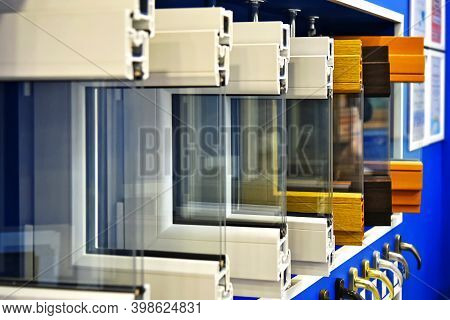 Samples Of Modern Window Profiles On A Special Showcase In The Room. Services For The Installation O