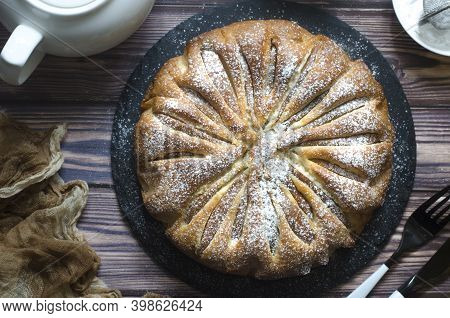 Pie With Pears And Powdered Sugar On A Board
