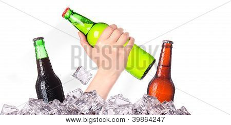 hand with bottle of beer breaks the ice isolated on a white background poster