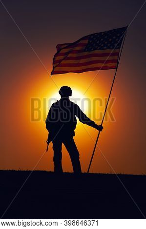 Silhouette Of Us Army Infantry Soldier, United States Marines Corps Fighter Standing On Sunset Horiz
