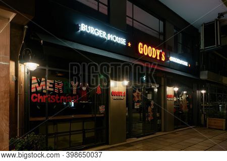 Thessaloniki, Greece - December 6 2020: Goodys Burger House Without Crowd. Illuminated Night View Of