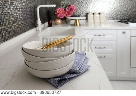 Beautiful Ceramic Dishware On Countertop In Modern Kitchen