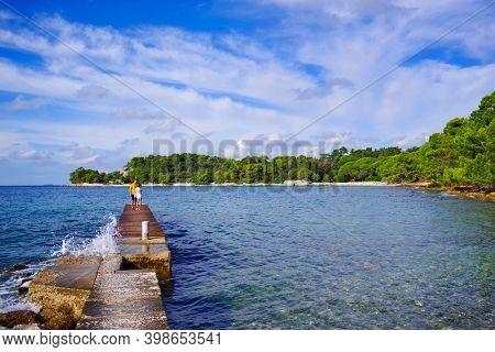 Tourists at Golden Cape Forest Park Zlatni rt, Rovinj (Rovigno) - Istria, Croatia