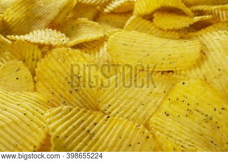 Potato Fluted Chips With Spices, Natural Product Close-up. Delicious Background. Text On Top Of The