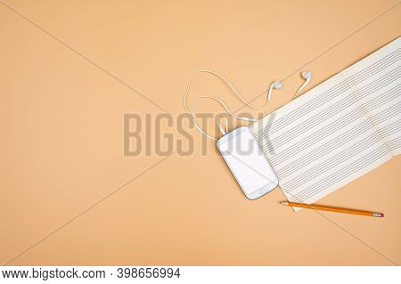 Top View Of The Music Notebook Empty Sheet Music. The Music Art Concept, Creating And Composing.comp