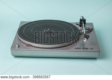 Vinyl Disc Player Without A Disc On A Blue Background. Retro Equipment For Playing Music.