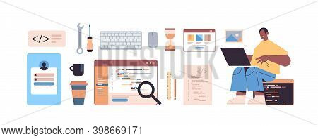 Male Web Developer Using Laptop Creating Program Code Development Of Software And Programming Icons