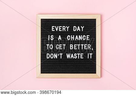 Every Day Is A Chance To Get Better, Dont Waste It. Motivational Quote On Black Letter Board On Pink