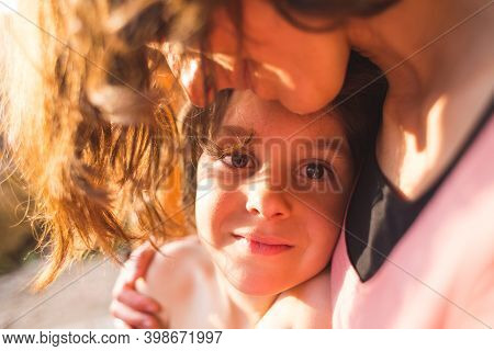Portrait Of A Child Hugging A Mother, A Boy Spends Time With Mom, A Woman Gently Hugs Her Son. Cute