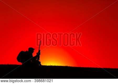 Silhouette Of Army Sniper, Special Forces Soldier, Professional Mercenary Or Hunter In Bonnie Hat, C