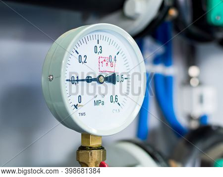 Close Up Of Pressure Meter, Manometer, Pipe, Flow Meter And Faucet Valves Of Heating System In A Boi