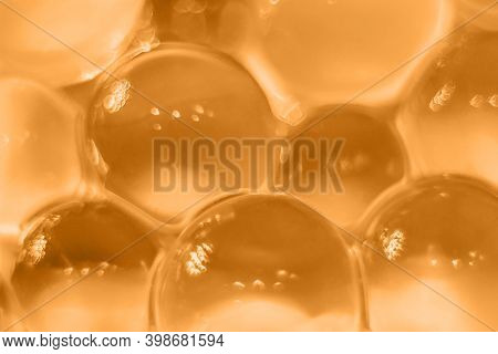 Abstract Orange Texture, Crystalline Balls Of Hydrogel For The Background. Hydrogel Beads. Close Up