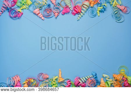 Party Background With Colorful Streamers For Celebrating Birthday. Space With Scattered Confetti. Co