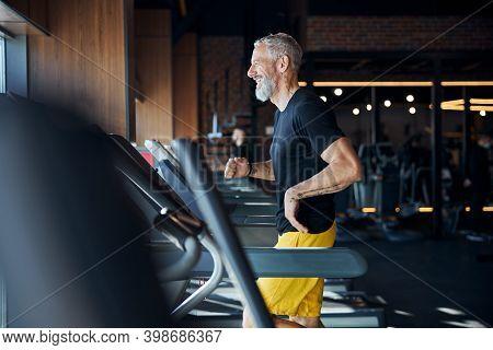 Joyous Caucasian Athlete Jogging On The Treadmill
